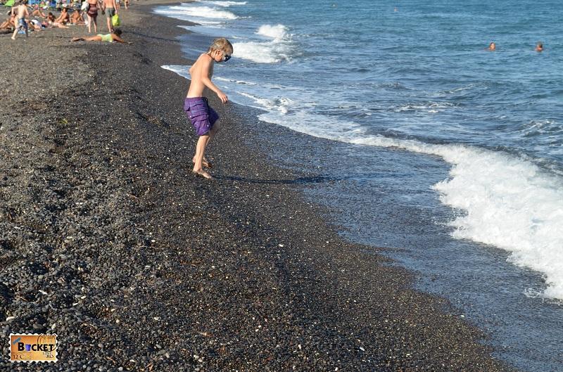 Kamari black pebbles beach
